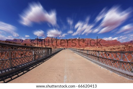 Clouds fly in the autumn wind on the bridge over the Colorado River - stock photo
