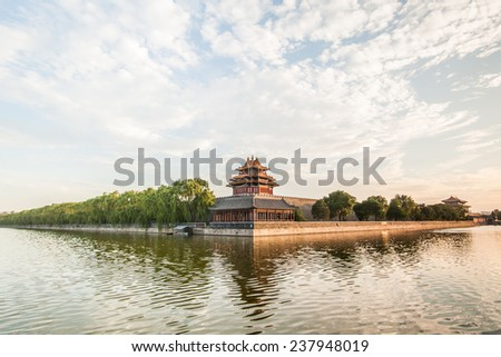 clouds fly over forbidden city's moat - stock photo