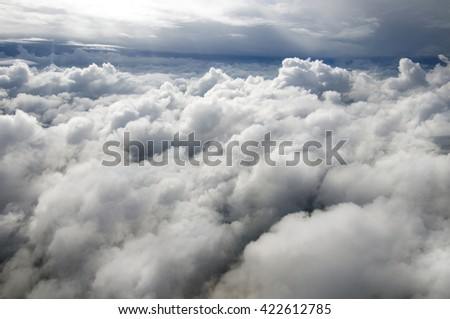 Clouds from above. Panorama over the white big clouds. Fluffy white clouds view from above, in the sky. Top view of the atmosphere with clouds. - stock photo