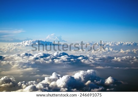 Clouds from above the sky blue space flight - stock photo