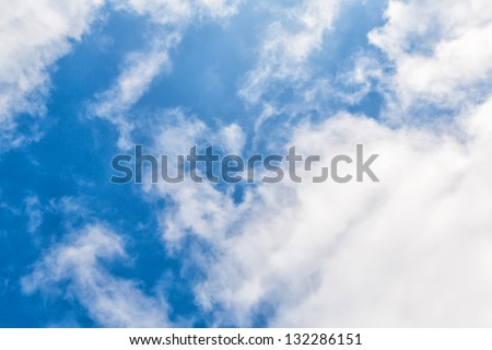 Clouds in blue sky as a background - stock photo