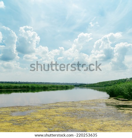 clouds in blue sky over river - stock photo