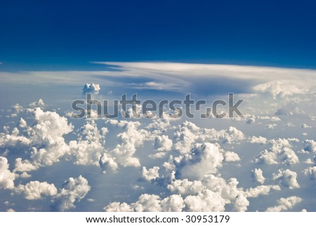 Clouds in flight over caribbean - stock photo