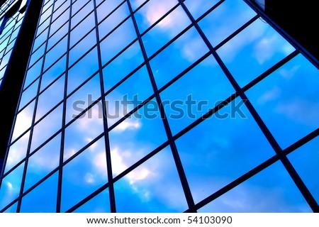 clouds in glazed panel skyscraper - stock photo