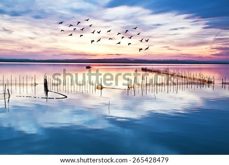 clouds in lake water - stock photo