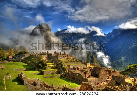 Clouds in Machu Picchu - the lost city of the Inca in HDR - stock photo