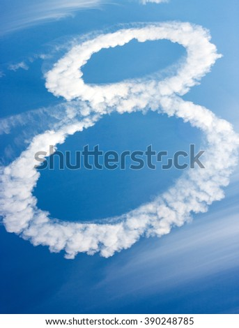 clouds in shape of figure eight on blue sky - stock photo