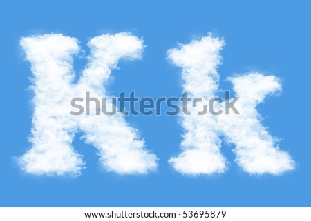 Clouds in shape of the letter K - stock photo