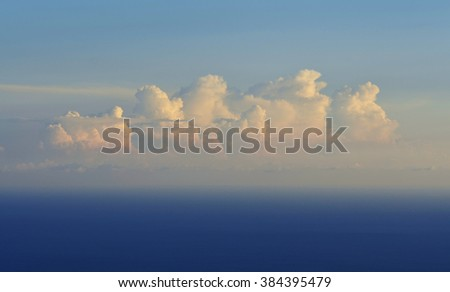 Clouds in the blue sky over the sea  at sunset - stock photo