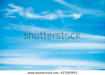 clouds in the dark blue sky background - stock photo