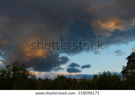 clouds in the setting sun