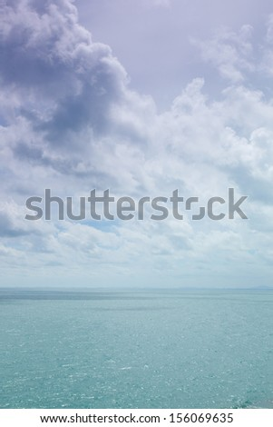 Clouds in the sky and the sea. The air was hot and bright during the daytime. - stock photo