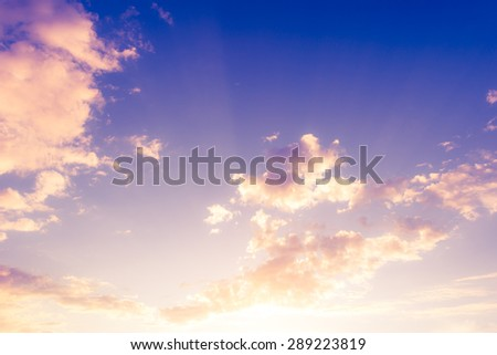 Clouds in the sky. Image in the soft orange-purple toning