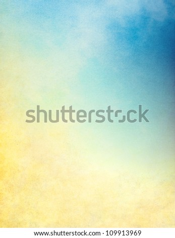 Clouds, mist and fog with vintage paper grain, textures, and grunge stains.  Image displays a yellow to blue gradient. - stock photo