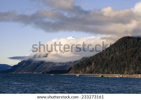 Clouds moving past mountains near the Chilkat river in Southeast Alaska.