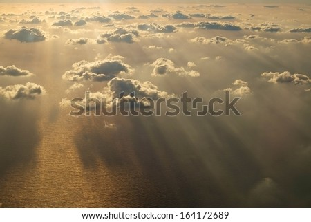 Clouds & Ocean view from airplane - stock photo