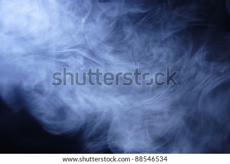 Clouds of blue cigarette smoke second hand smoke from a cigarette - stock photo