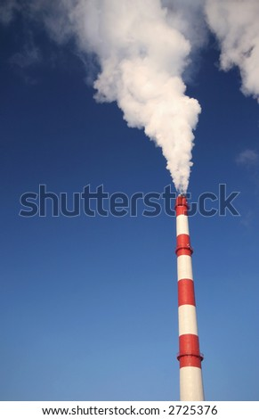 Clouds of white smoke in blue sky