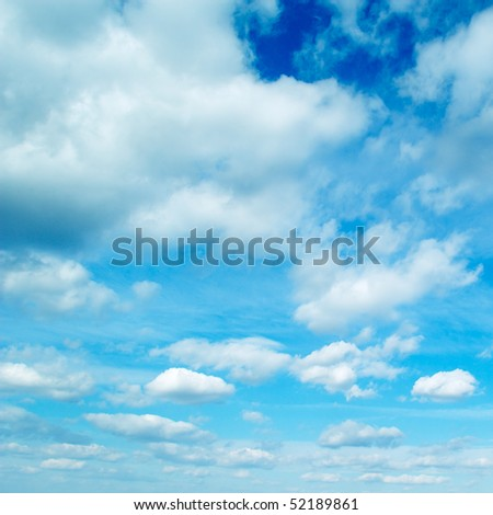 clouds on a background of the blue sky - stock photo