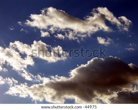 Clouds, on a blue sky - stock photo
