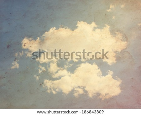 clouds on a paper overlay done with a retro vintage instagram filter - stock photo