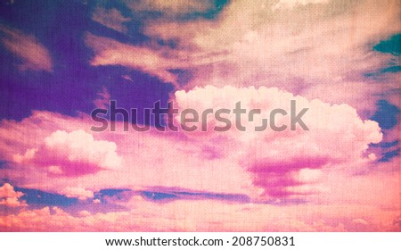 Clouds on a textured vintage paper background, with grunge stains, retro filters applied - stock photo