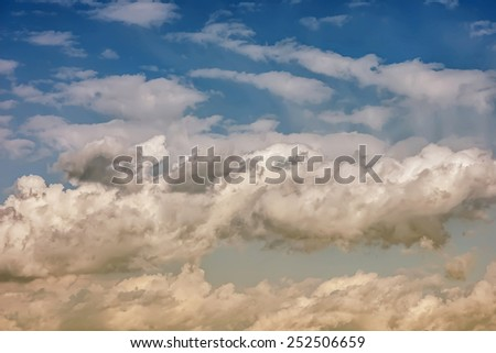 Clouds on blue sky at sunset - stock photo