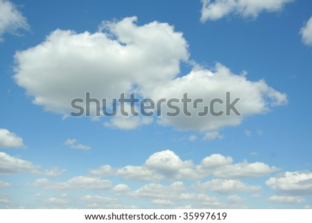 Clouds on blue sky. Background - stock photo