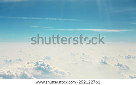 Clouds on blue sky view from plane - stock photo