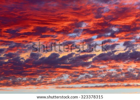 Clouds on sunset sky blue and red natural background