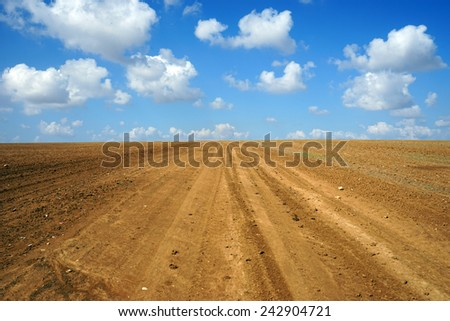 Clouds on the sky and plowed land in Israel
