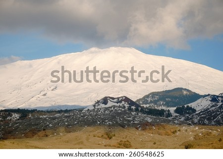 clouds on the snowy volcano Etna National Park, Sicily - stock photo