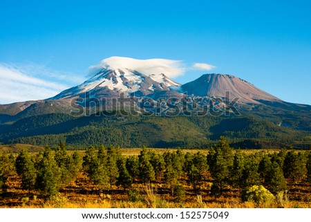 Clouds on top of Mount Shasta, California - stock photo