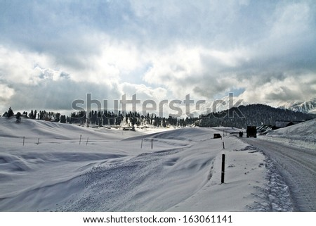 Clouds over a snow covered landscape, Kashmir, Jammu And Kashmir, India