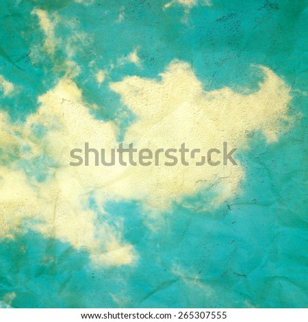 Clouds over blue sky. Color toning effect was applied. - stock photo