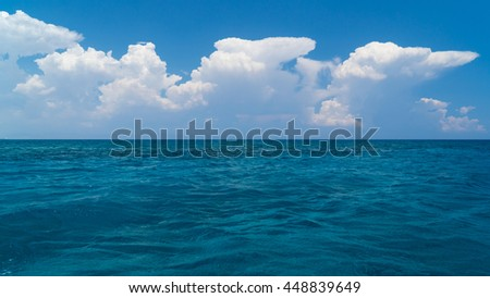Clouds over crystal clear waters of Mediterranean sea