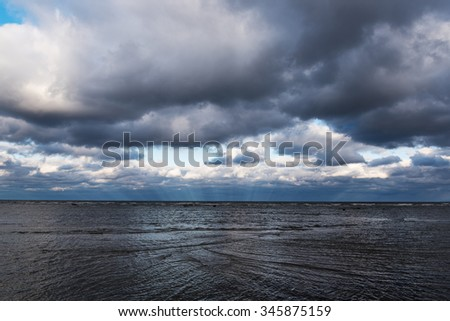 Clouds over gulf of Riga, Baltic sea. - stock photo