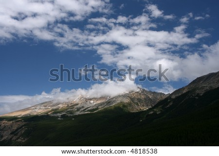 Clouds over mountains - beautiful vista in Jasper National Park, Canada.