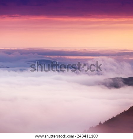 clouds over mountains in sunrise time, summer landscape - stock photo