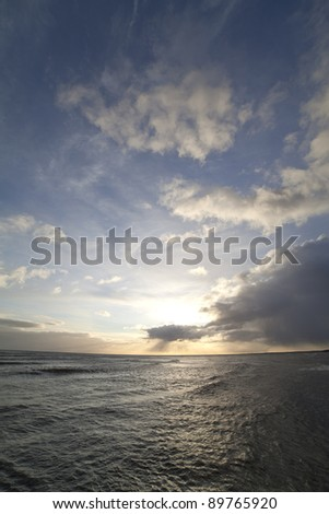 Clouds over sea. - stock photo