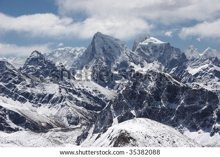 Clouds over snow mountains landscape, Himalaya - stock photo