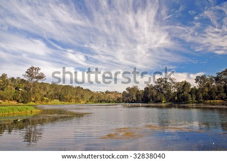 Clouds over the Brisbane River at Colleges Crossing in Ipswich - stock photo