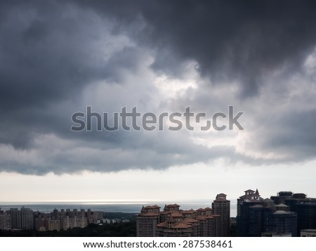 clouds over the city - stock photo