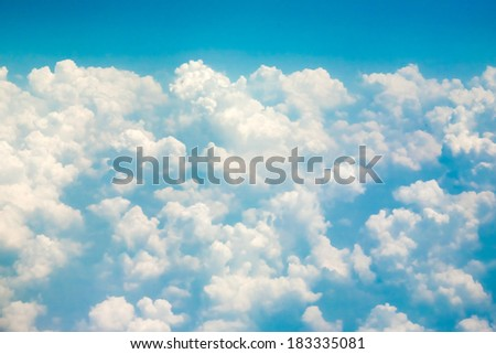 Clouds over the ocean airplane view - stock photo
