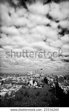 Clouds over the ruins of Volubilis, Morocco - stock photo