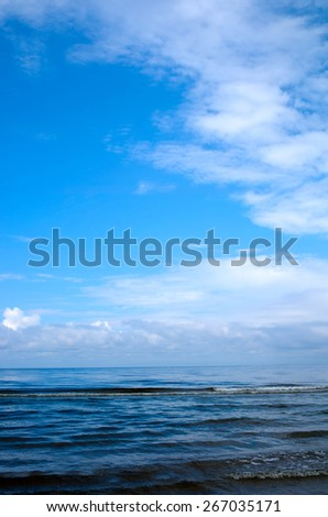 clouds over the sea near the shoreline - stock photo