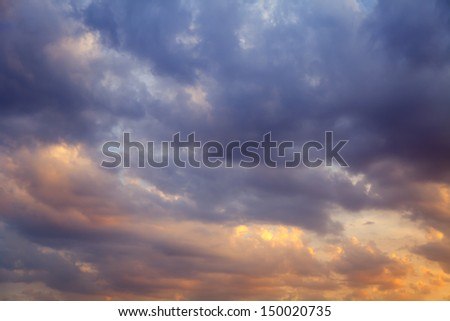 Clouds, painted sun at sunset