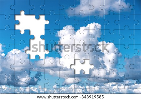 Clouds puzzle with two missing pieces - a concept of cloud computing building blocks - stock photo