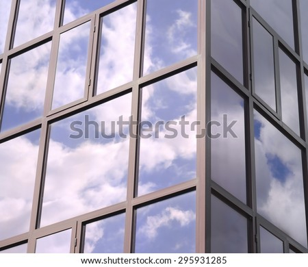 Clouds reflected in the tinted Windows of the building. - stock photo