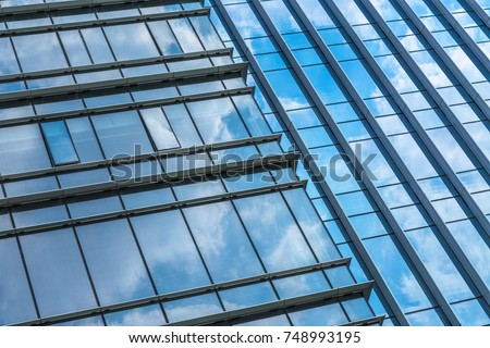 Clouds Reflected in Windows of Modern Office Building.